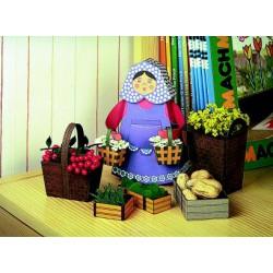 Vendedora con canastas y cajas